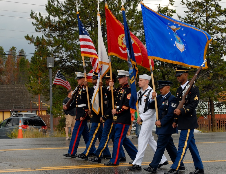 NORAD U.S. Northern Command Joint Color Guard members march with the colors during the Salute to American Veterans Rally and Festival parade in Winter Park, Colo., Aug. 15. Each service was represented at the rally. (U.S. Air Force photo by Senior Airman Stephen Musal)