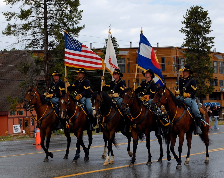 Soldiers from Fort Carson provide a mounted color guard for the Salute to American Veterans Rally and Festival parade in Winter Park, Colo., Aug. 15. (U.S. Air Force photo by Senior Airman Stephen Musal)