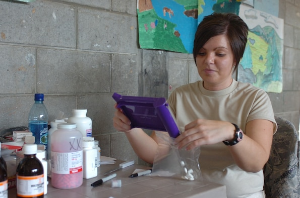 Dispensing Meds – Senior Airman Kelli Reed, pharmacy technician with the 188th Fighter Wing of the Arkansas Air National Guard, sorts medications in a make shift pharmacy in the village of San Miguel Chicaj, Guatemala.  The members of the Arkansas Air Guard are in Guatemala as part of their annual training conducting a 15-day Medical Readiness Training Exercise in concert with the Guatemalan Army. (Air Force Photo by Maj. Keith Moore, Public Affairs Officer, Joint Force Headquarters Arkansas Air National Guard)