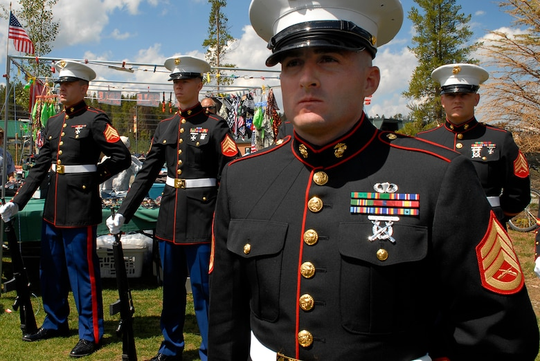 Marine Staff Sgt. Robert Ashby, Marine Air Control Squadron 23, stands at parade rest during the veterans' ceremony. Nine Marines from MACS-23 marched in the parade with several Marines from a local recruiting station. (U.S. Air Force photo by Tech. Sgt. J. LaVoie)