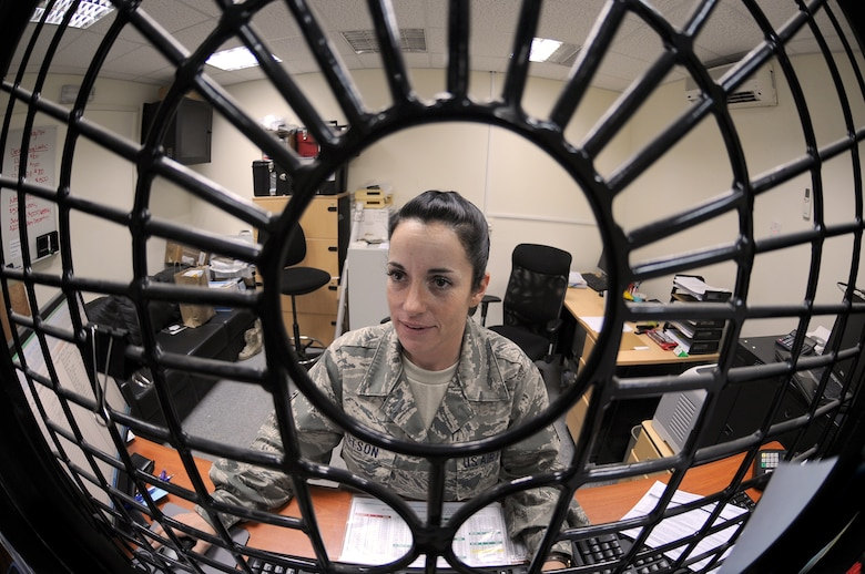 SOUTHWEST ASIA -Staff Sgt. Keri Watson, 380th Air Expeditionary Wing Finance Office, provides customers with financial assistance Aug. 17. Sergeant Watson is deployed from the 162nd Fighter Wing, and hails from Tucson, Ariz. (U.S. Air Force photo/Tech. Sgt. Charles Larkin Sr)