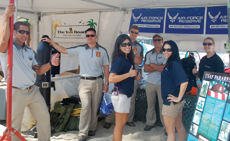 Reserve recruiters from the Western Recruiting Squadron based at March ARB work together to look for future pararescuemen at a San Clemente Ocean Festival booth, July 18. (U.S. Air Force courtesy photo)
