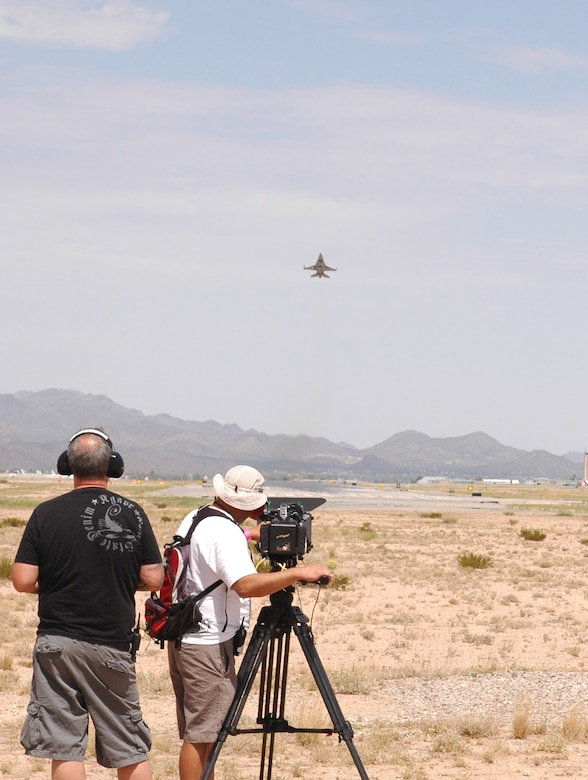 A United Arab Emirates F-16E Desert Falcon, block 60, takes off from Tucson International Airport while a documentary film crew captures the moment Aug. 12. Recognizing the historic significance of their first Red Flag, the U.A.E. government commissioned a production company to follow pilots and maintainers through the experience. (Air National Guard photo by Capt. Dan Dodson)