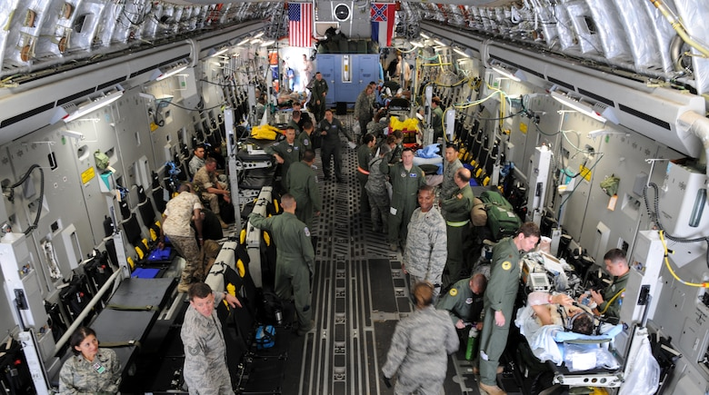 U.S. Military Forces from the 86th Contingency Aeromedical Staging Facility and 86th Aeromedical Evacuation Squadron prepare a C-17 Globemaster III to load wounded warriors on Ramstein Air Base, Germany, Aug. 18, 2009. From Ramstein, the wounded warriors get loaded on a C-17 Globemaster III to transport them to Walter Reed Army Medical Facility, Washington, D.C. for further medical treatment. (U.S. Air Force photo by Airman 1st Class Grovert Fuentes-Contreras)