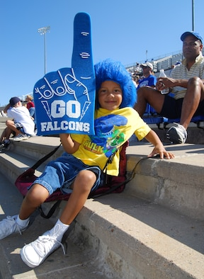 Jonathan Terrence Durant, age 5, poses for a photo in Falcon Stadium at the U.S. Air Force Academy, Colo., Aug. 22, 2009. Jonathan and about 1,000 other fans, large and small, attended a Falcons scrimmage at the stadium and stayed afterward to meet the 2009 football team. Jonathan's father, Col. James Durant (right), is deputy department head for the Department of Law. (U.S. Air Force photo/Staff Sgt. Don Branum)