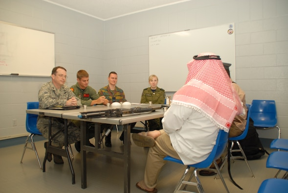 """Coalition aircrew members from the U.S., Canada and Belgium meet with Airmen posing as Iraqi nationals on Aug. 18, 2009, at Little Rock Air Force Base, Ark., as part of Joint Readiness Training Center Exercise 09-09. The meeting is irregular warfare training which is part of Green Flag Little Rock -- the base's name for their participation in the JRTC exercise.  GFLR is designed to give aircrews their first five combat flights in a controlled environment and held in conjunction with the JRTC exercise based at Fort Polk, La., which is training 3,200 Soldiers """"deployed"""" to an austere environment.  GFLR provides training for the aircrews that perform airlift and airdrop missions, aeromedical evacuation and bare-base set up and operations for the JRTC exercise.  (U.S. Air Force Photo/Capt. Joe Knable)"""