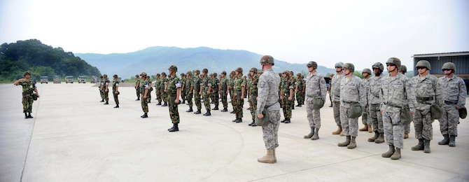 Airmen from the 51st Civil Engineer Squadron stand in formation before participating in a joint combined rapid runway repair training exercise with Airmen from the Republic of Korea Air Force's 19th Tactical Fighter Wing and 91st Air Civil Engineer Group at Jungwon Air Base, Republic of Korea, Aug 19. (U.S. Air Force photo/Senior Airmen Stephenie Wade)