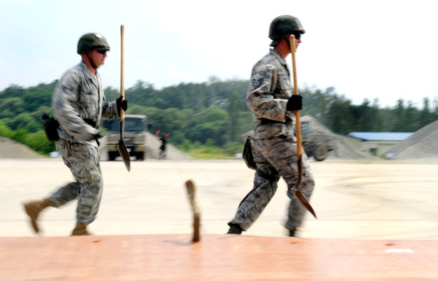 Staff Sgt. Tony Anderson, right, and Technical Sgt. Robert Barnett run to assist in moving of a folded fiberglass mat at Jungwon Air Base, Republic of Korea Aug 19. The Airmen are a part of a joint combined rapid runway repair training exercise with Airmen from the Republic of Korea Air Force's 19th Tactical Fighter Wing and 91st Air Civil Engineer Group.  Sergeants Anderson and Barnett are assigned to the 51st Civil Engineer Squadron, Osan Air Base, Republic of Korea. (U.S. Air Force photo/ Senior Airmen Stephenie Wade)