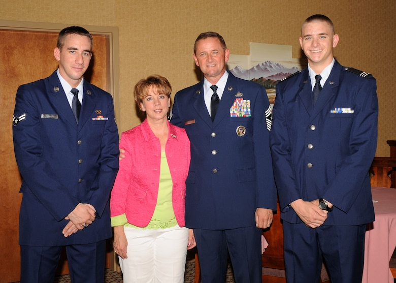DAVIS-MONTHAN AIR FORCE BASE, Ariz. -- Chief Master Sgt. Lloyd Hollen (middle right), 12th Air Force (Air Forces Southern) command chief, stands with his wife Carol, and their two sons, Terry (left), an Airman 1st Class imagery analyst at Beale Air Force Base, Calif., and Greg (right), a Reserve Officer Training Corps Cadet Major at Florida State University.  Chief Hollen retired Aug. 14 after nearly 29 years of active service.  His sons emceed the retirement ceremony. (U.S. Air Force photo by Airman 1st Class Brittany Dowdle)
