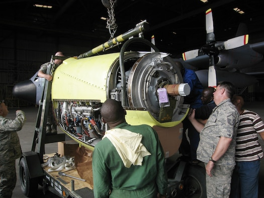 Master Sgt. Jim Goostree examines the engine from a Nigerian C-130 as part of an effort to restore the aircraft to flying condition. Once able to fly, it will go to a repair Depot in Europe for a more extensive overhaul. The mission is part of an ongoing military-to-military engagement between 17th Air Force (U.S. Air Forces Africa) and the West African nation. Sergeant Goostree is a member of the Tennessee Air National Guard's 118th Airlift Wing. (U.S. Air Force photo/Lt. Col. David MacKenzie)