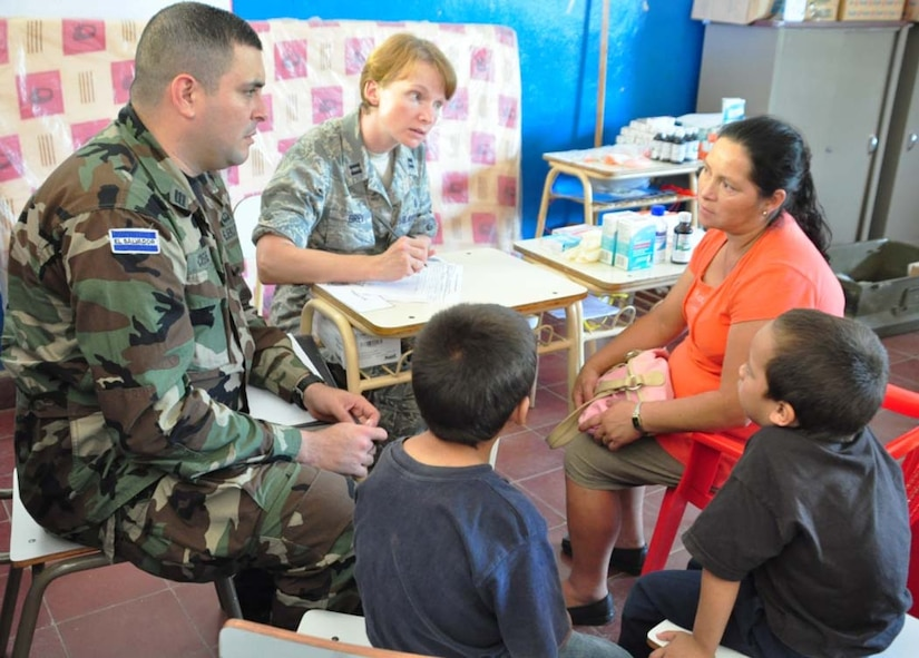 SAN FERNANDO, El Salvador – Capt. Ernesto Cristales, translator from the Salvadoran army, and Air Force Capt. Krista Grey, Medical Element registered nurse, Joint Task Force-Bravo, discuss symptoms with Salvadoran patients during a Medical Readiness Training Exercise here Aug. 25. During the two-day MEDRETE, a combined U.S. and Salvadoran team provides free medical care to the members of the village. In the MEDRETE's first day, the medical team treated 364 Salvadoran patients (U.S. Air Force photo/1st Lt. Jennifer Richard).