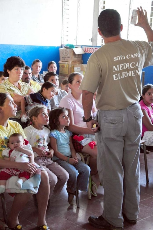 SAN FERNANDO, El Salvador – Dr. Wilmer Amador, Medical Element liaison officer, Joint Task Force-Bravo, gives a preventive health briefing to Salvadoran patients during a Medical Readiness Training Exercise here Aug. 25. During the two-day MEDRETE, a combined U.S. and Salvadoran team provides free medical care to the members of the village. In the MEDRETE's first day, the medical team treated 364 Salvadoran patients (U.S. Air Force photo/1st Lt. Jennifer Richard).