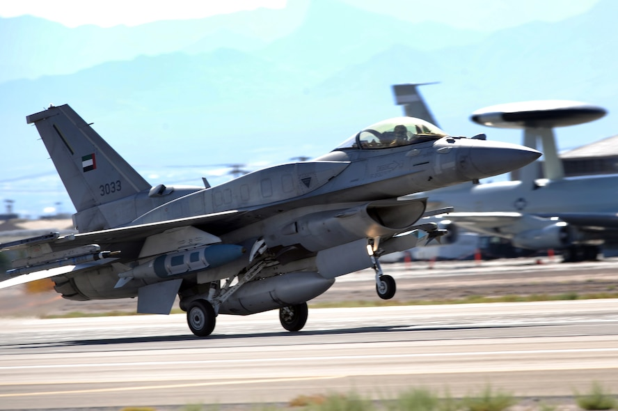 NELLIS AIR FORCE BASE Nev.-- An F-16E from Al Dhafra Air Base, United Arab Emirates takes off for a training mission during Red Flag 09-5 Aug. 26.  This is the first time the nation has participated in Red Flag--a realistic air combat training exercise conducted over the 15,000-square-mile Nevada Test and Training Range north of Las Vegas. The two-week exercise is administered through the 414th Combat Training Squadron at Nellis Air Force Base and is just one in a series of advanced training programs offered by the U.S. Air Force Warfare Center. In addition to the United Arab Emirates, U.S. Air Force, Navy and Marines Corps units from Nevada, Massachusetts, Utah, Louisiana, California, Washington, Oklahoma, Florida and Kansas; as well as allied forces from Italy are participating in Red Flag 09-5.  The exercise ends Sept. 4. (U. S. Air Force photo by Tech. Sgt. Michael R. Holzworth/Released)
