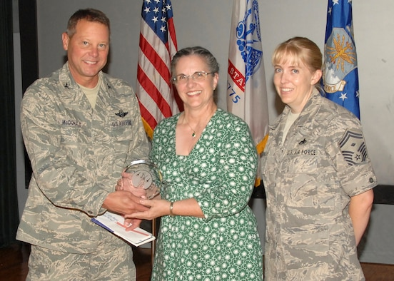 ANDREWS AIR FORCE BASE, Md. - Col. Michael J. McDonald, the commander of the Air National Guard Readiness Center, presents the Civilian of the Quarter, Category 1 award to Edna C. Davis, a secretary at The I.G. Brown Air National Guard Training and Education Center, McGhee Tyson Air National Guard Base, Tenn., on Aug. 21. (U.S. Air Force photo by Master Sgt. Jerry R. Bynum)(Released)