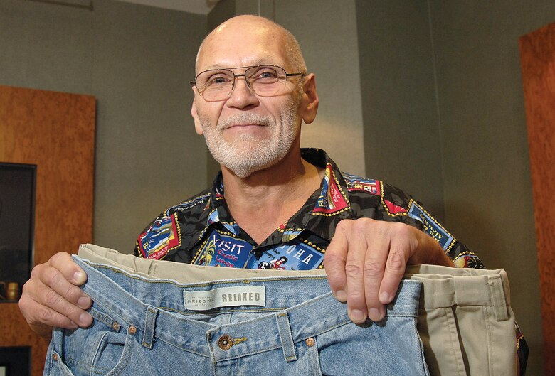 """When Jimmy Nation had to """"come back up for air"""" just to put on his shoes it was an incentive to begin a weight loss journey that keeps yielding happy results.  His pant size shrinking from a 44- to a 38-inch waist is positive reinforcement of the progress the 76th Maintenance Operation Center production controller has made. (Air Force photo by Margo Wright)"""
