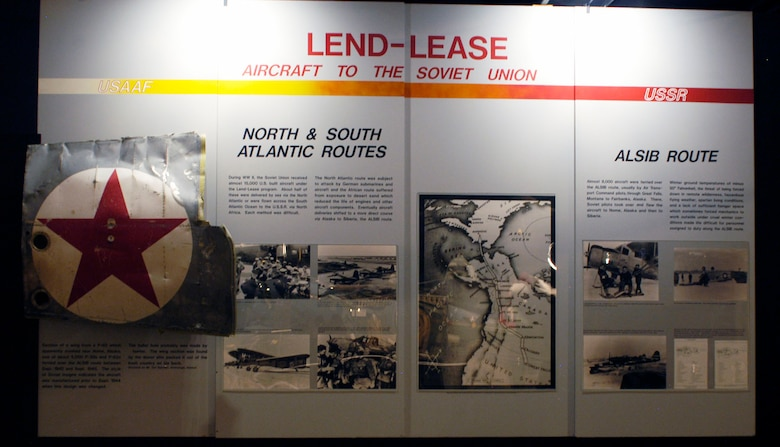 DAYTON, Ohio -- Lend-Lease exhibit in the World War II Gallery at the National Museum of the U.S. Air Force. The exhibit includes a section of a wing from a P-63 that apparently crashed near Nome, Alaska, one of about 5,000 P-39s and P-63s ferried over the ALSIB route between September 1942 and September 1945. (U.S. Air Force photo)