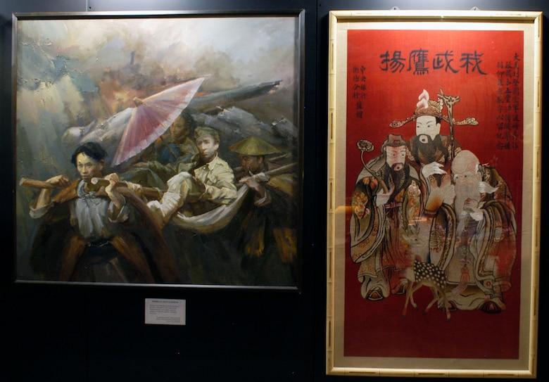 "DAYTON, Ohio -- ""Sending U.S. Pilot to Hospital"" painting (on left) by Zhang Renyuan. (U.S. Air Force photo)"