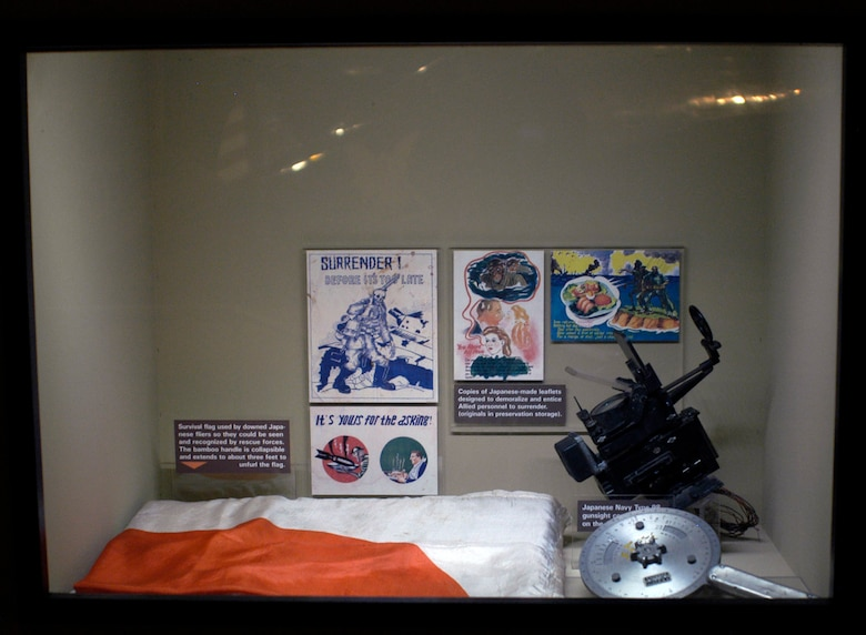 DAYTON, Ohio -- Japanese artifacts, including Japanese-made leaflets, a survival flag used by downed Japanese flyers, and a Japanese gunsight, are on display in the World War II Gallery at the National Museum of the U.S. Air Force. (U.S. Air Force photo)