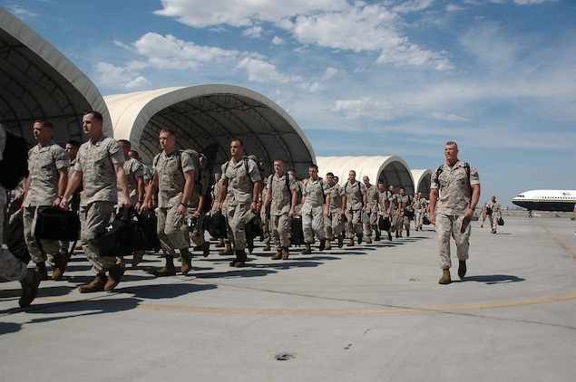 Marine Attack Squadron 211 and Marine Aviation Logistics Squadron 13 Marines march to VMA-211's hangar at the Marine Corps Air Station in Yuma, Ariz., Aug. 29, 2009, after a seven-month deployment aboard the USS Essex. The 80 Yuma Marines served with the 31st Marine Expeditionary Unit, providing offensive air support, reconnaissance and limited air defense during multinational training exercises.