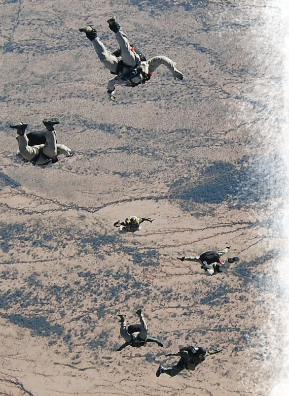 Pararescuemen from the 306th Rescue Squadron at Davis-Monthan Air Force Base train in the desert near Tucson, Arizona. Approximately 25% of the Airmen in the squadron are Active Guard Reserve). (U.S. Air Force photo)