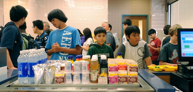 Osan Middle School students wait to pay for lunch on the first day of school, Aug 31. The school is a new addition to Osan Air Base, with more than 140 students enrolled in grades 6-8.   (U.S. Air Force photo/Staff Sgt. Brian Ferguson)