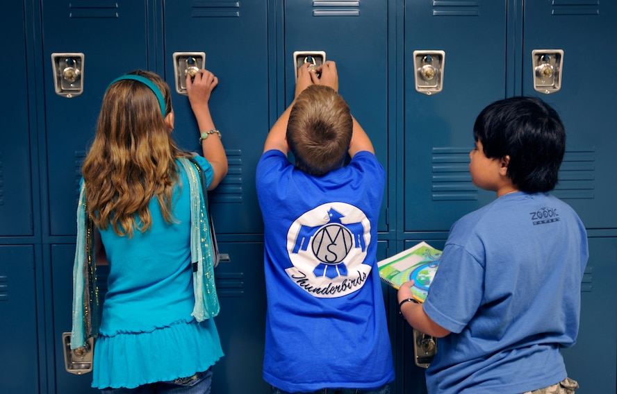 Osan Middle School students visit their lockers before lunch on the first day of school, Aug 31. The school is a new addition to Osan Air Base, with more than 140 students enrolled in grades 6-8.   (U.S. Air Force photo/Staff Sgt. Brian Ferguson)
