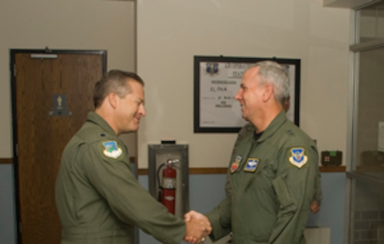 Maj. Gen. Floyd Carpenter, 8th Air Force commander, visited the 102nd Air Operations Group Aug. 21-22.  Pictured above, General Carpenter is greeted by Lt. Col. Richard Sweeten, 102nd Air Operations Group commander. The general was given a briefing on the AOG?s mission that supports the 608th Air and Space Operations Center at Barksdale AFB, La., and then a tour of the facilities. Carpenter said that with cuts to active duty manning, he needs Otis now more than ever to support his command and control requirements for the Global Strike mission. General Carpenter is also the Joint Functional Component Commander for Global Strike, United States Strategic Command.