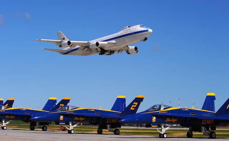 OFFUTT AIR FORCE BASE Neb. -- A Boeing E-4B, an airborne command post, fly's over the U.S. Navy Blue Angels F-18s during the 2009 Defenders of Freedom Open House and Air Show here Aug. 29 - 30. The E-4B serves as the National Airborne Operations Center for the president, secretary of defense and the Joint Chiefs of Staff. In response to an emergency, the aircraft can provide a highly survivable, command, control and communications center to direct U.S. forces, execute emergency war orders and coordinate actions by civil authorities. U.S. Air Force Photo by Josh Plueger