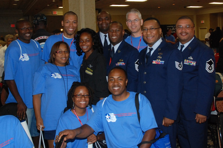 Members of the 94th Airlift Wing meet 15-year-old Kimberly Anyadike (in black) at the 2009 Tuskegee Airman National Convention student luncheon Aug. 8 in Las Vegas, Nev. Kimberly holds the record as the youngest African-American female to fly a plane across the United States solo.