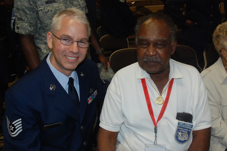 Tech. Sgt. Jeffery T. Nix, 94th Airlift Wing Equal Opportunity, greets Herbert L. Blackmon, Jr., member of the Tuskegee Airman, Inc. Lt. Gen. Benjamin O. Davis Chapter at the TAI National Convention in Las Vegas Aug. 7.  (U.S. Air Force photo/Tech. Sgt. James Branch)