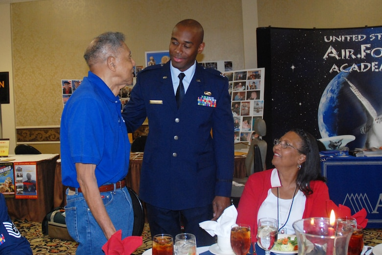 Capt. Toney Collins, 94th Logistics Readiness Squadron, greets Original Tuskegee Airman Boyd Taylor from the Spanky Roberts Tuskegee Airman Chapter in Sacramento, Calif., and his wife Gloria at the 2009 Tuskegee Airman National Convention welcome reception in Las Vegas, Nev. Aug. 7. (U.S. Air Force photo/Tech. Sgt. James Branch)