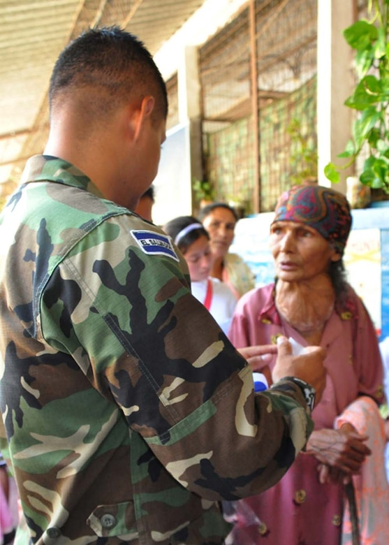 SAN FERNANDO, El Salvador — Aurelia Lopez, 87, receives medicine from a Honduran soldier after seeing an American doctor in the medical readiness and training exercise here Aug. 26. Ms. Lopez walked two hours round-trip to the medical exercise, where she received medical care for the first time in 40 years. A team of personnel from Joint Task Force-Bravo, the Salvadoran military and the Salvadoran Ministry of Health worked together during the two-day medical exercise to provide free medical care to more than 900 patients (U.S. Air Force photo/1st Lt. Jennifer Richard).