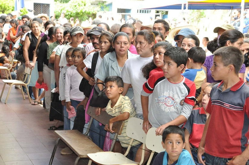 SAN FERNANDO, El Salvador — A crowd gathers and waits to receive free medical care during a medical readiness and training exercise, or MEDRETE, here Aug. 26. Residents of the San Fernando area walked hours to the medical exercise, where many of them saw doctors for the first time in decades. A team of personnel from Joint Task Force-Bravo, the Salvadoran military and the Salvadoran Ministry of Health worked together during the two-day medical exercise to provide free medical care to more than 900 patients (U.S. Air Force photo/1st Lt. Jennifer Richard).
