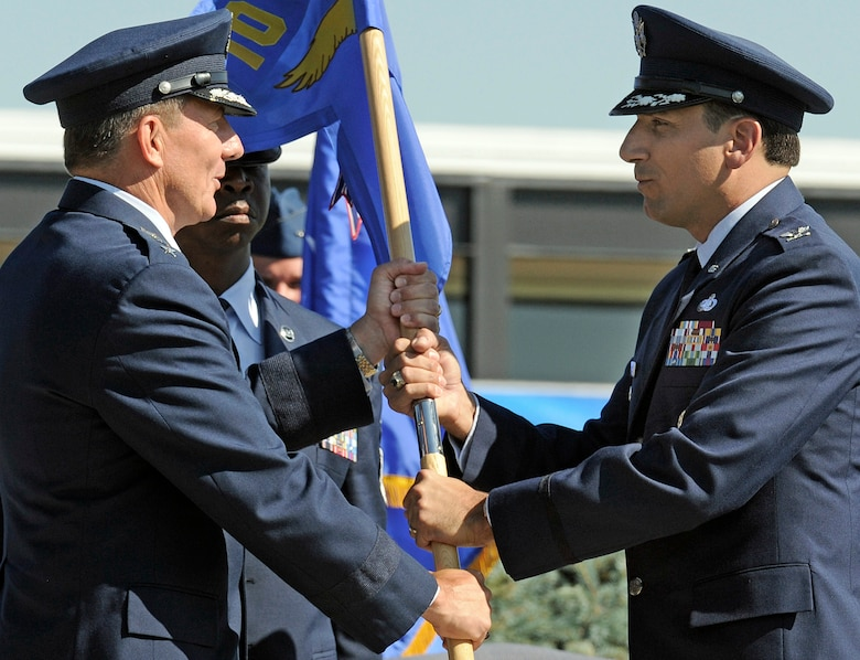Col. Rick LoCastro, right, accepts the 10th Air Base Wing guidon from Lt. Gen. Mike Gould during the 10th ABW change-of-command ceremony at the U.S. Air Force Academy July 23, 2009. Colonel LoCastro was previously vice commander of the 96th ABW at Eglin Air Force Base, Fla. General Gould is the Academy superintendent. (U.S. Air Force photo/Mike Kaplan)