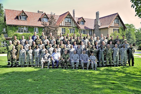 IJOLDS students pose for their class photo in front of the officer's mess at the Canadian Forces College. The International Junior Officer Development Seminar was held in Toronto, Ontario, Canada Aug 17-21.