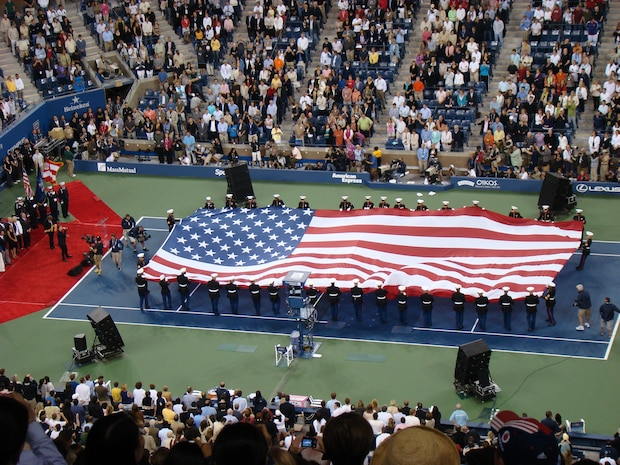 Marines from 6th Communications Battalion, 4th Marine Logistics Group, unfurl an American Flag across the tennis court during the opening ceremony for the U.S. Open at USTA Billie Jean King National Tennis Center, New York City. This is the 127th year of the annual tennis tournament. (Official Marine Corps photo by New York City Public Affairs Office)