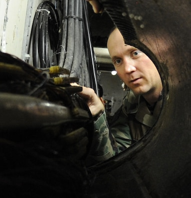 WHITEMAN AIR FORCE BASE, Mo., - Staff Sgt. Carl Smith, 509th Communications Squadron, inspects the main network lines exiting the communication focal point, for wear and tear, Dec. 1. The communication focal point provides customers on base a one-stop shop, servicing phone and network servers, base-wide.  (U.S. Air Force Photo/Airman 1st Class Carlin Leslie)(released)