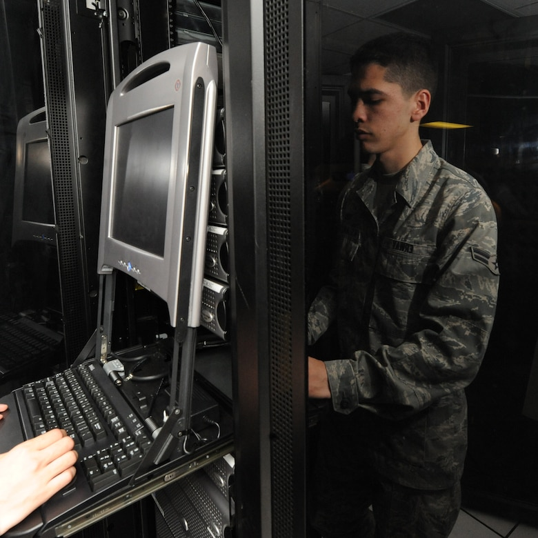 WHITEMAN AIR FORCE BASE, Mo., - Airman First Class Scott Erway, 509th Communication Squadron, runs a system check on a network server to find which system component had failed, Dec. 1. The communication focal point provides customers on base a one-stop shop, servicing phone and network servers, base-wide.  (U.S. Air Force Photo/Airman 1st Class Carlin Leslie)(released)