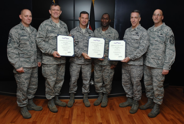 (Left to right) U.S. Air Force Chief Master Sgt. Dennis Vannorsdall, 3rd Air Force command chief; Lt. Gen. Frank Gorenc, 3rd AF commander; Brig. Gen. Mark Dillon, 86th Airlift Wing commander; Chief Master Sgt. Vernon Butler, 86th AW command chief; Col. Thomas Gould, 435th Air Ground Operations Wing commander; and Chief Master Sgt. Stippel, 435th AGOW command chief, stand with the Air Force Outstanding Unit Award certificates for their units. Each unit won the award for their exceptional service, and Ramstein Airmen assigned to one of the three units during the timeframe of their awards are authorized to wear the AFOUA ribbon. (U.S. Air Force photo by Airman 1st Class Brittany Perry)