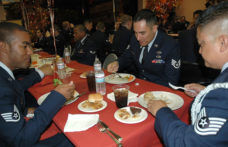 Members from Los Angeles Air Force Base enjoy a bountiful turkey dinner provided by Jay Leno's staff after NBC's military tribute on Thanksgiving Day, Nov. 26. The participants came from various military bases around Southern California to be a part of the all-military audience for this annual event held at NBC Studios in Burbank, Calif. (Photo by 2nd Lt. Mara Title)