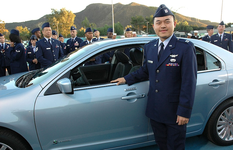 Capt. Tung Ngo from Los Angeles Air Force Base won a new 2010 Ford Fusion Hybrid from a drawing at the Jay Leno Show's all-military tribute held at NBC Studios in Burbank, Calif., on Thanksgiving Day, Nov. 26. Captain Ngo was one of more than 200 military audience members to participate in the annual event. (Photo by 2nd Lt. Mara Title)