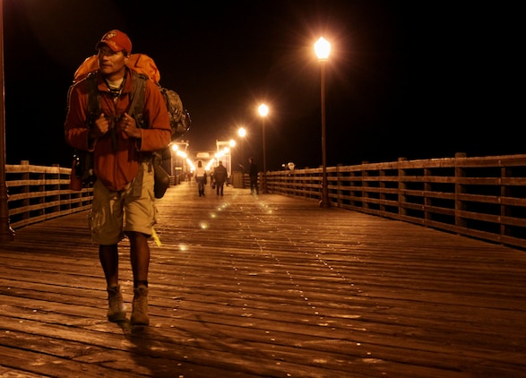 Eddie Gray, a former Marine rifleman with 1st Battalion, 6th Marines, 2nd Marine Division, visits Oceanside Pier, Oceanside, Calif., Dec 3, during a 12,000-mile walk around the U.S. perimeter. Gray began the walk to honor the sacrifices of all service members after losing more than 14 comrades in the Iraqi and Afghan conflicts. The journey began almost two years ago and he expects to finish in the next three years.