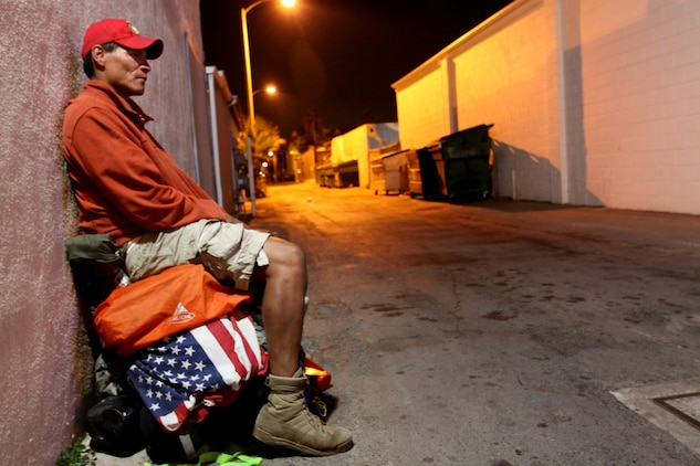 Eddie Gray, a former Marine rifleman with 1st Battalion, 6th Marines, 2nd Marine Division, sits on top of his pack for a brief rest in Oceanside, Calif., Dec. 3, before continuing a 12,000-mile walk around America's perimeter. Gray began the walk to honor the sacrifices of all service members after losing more than 14 comrades in the Iraqi and Afghan conflicts. The journey began almost two years ago and he expects to finish in the next three years.