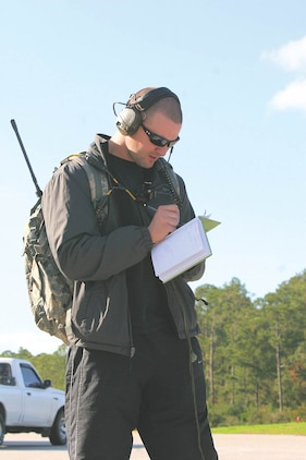 Staff Sgt. Stewart Fergusson, a joint terminal air controller with the 17th Air Support Operations Squadron wrote down targetting information in preparation to pass on coordinates to the pilots, Dec. 4.