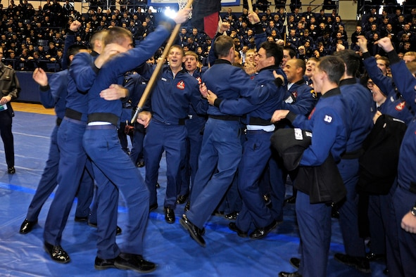 """Cadet Squadron 23 cadets celebrate their second-straight victory in the Commandant's Challenge at the Air Force Academy's Clune Arena Nov. 24, 2009. CS23 also shared first place in the """"Falcon Feud"""" military knowledge competition with CS40. (U.S. Air Force photo/Johnny Wilson)"""