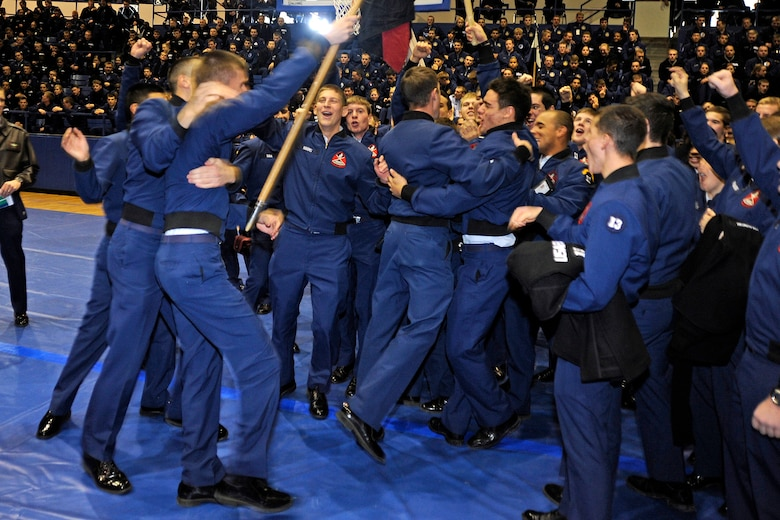 "Cadet Squadron 23 cadets celebrate their second-straight victory in the Commandant's Challenge at the Air Force Academy's Clune Arena Nov. 24, 2009. CS23 also shared first place in the ""Falcon Feud"" military knowledge competition with CS40. (U.S. Air Force photo/Johnny Wilson)"