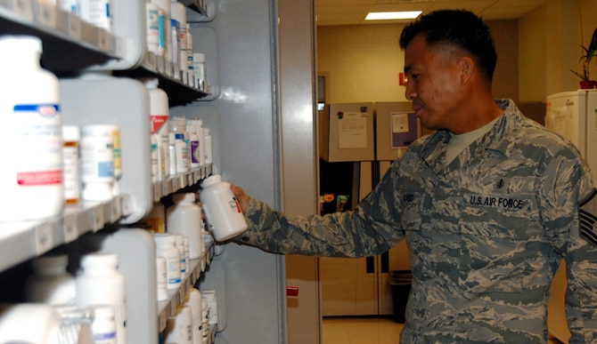 ANDERSEN AIR FORCE BASE, Guam - Master Sgt. Danny Acasio, 36th Medical Support Squadron NCO-in-charge of pharmacy services, places a bottle of medication on a shelf in the clinic pharmacy here Dec. 2. The pharmacy processes an average of 150 prescriptions per day. (U.S. Air Force photo by Senior Airman Shane Dunaway)
