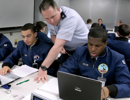 Lt. Col. Jeff Boleng looks over then-Cadets 3rd Class Bradford Smith and James Colvin III during a computer science course at the Air Force Academy in Colorado Springs, Colo., Feb. 2, 2009. The Academy officially received its 10-year accreditation from the Higher Learning Commission of the North Central Association of Colleges and Schools Oct. 27. Colonel Boleng is the deputy department head for the Department of Computer Science and an associate professor. (U.S. Air Force photo/David Armer)