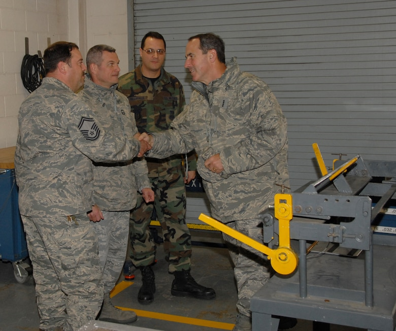 During a recent visit to the Niagara Falls Air Reserve Station, General Raymond Johns, Jr., AMC, Commander, toured a variety of groups and squadrons. This tour enabled the general to receive a firsthand feel of the association between the New York Air National Guard's 107th Airlift Wing and the Air Force Reserve's 914th Airlift Wing.  Front to back: The general is greeted by Senior Master Sgt's Steven Buchwald, 107th AW, Stephen Trosterud, 914thth AW and Joe Dellavalle, 914th AW. (U.S. Air Force Photo/Senior Master Sgt. Ray Lloyd)