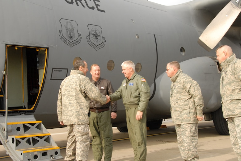 The new Air Mobility Commander, Gen. Raymond Johns, Jr. is greeted by the commanders of the Niagara Falls Air Reserve Station. Niagara was one of the numerous stop the general has made during his tour of Air Force Bases under his command.  Above: Col. Patrick Ginavan, 107th AW, Commander, welcomes the general to Niagara. To the left of the colonel is Col. Allan Swartzmiller, 914th AW, Commander, to the right is Chief Master Sgt. Scott Scharlau, 914th AW, Command Chief and Chief Master Sgt. Richard King, 107th AW, Command Chief. (U.S. Air Force Photo/Senior Master Sgt. Ray Lloyd)